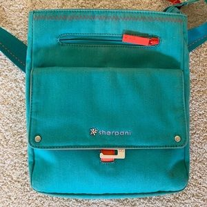 Sherpani turquoise/orange crossbody bag